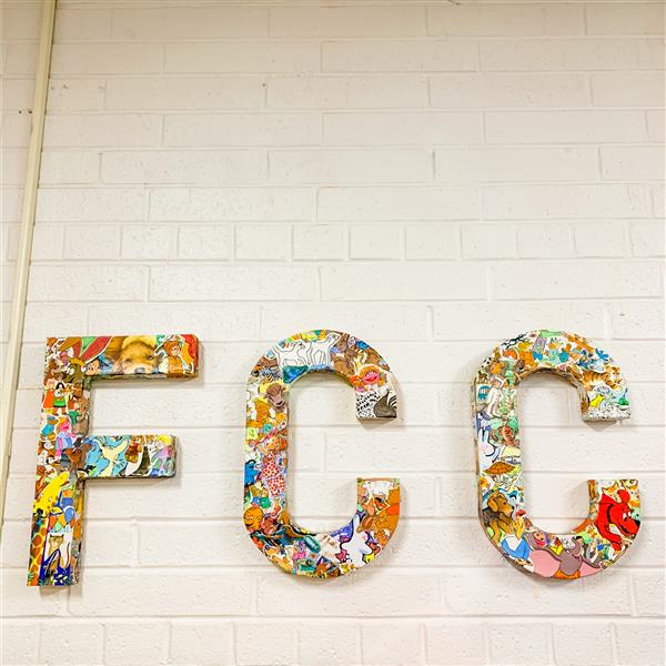 FCC letters on wall