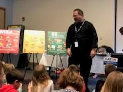 MCPS Staff member Ed Christensen speaking to students about nutrition.
