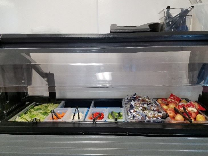 View of a fully stocked salad bar.