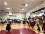 Hawthorne Student Music Program with students dancing in the gymnasium